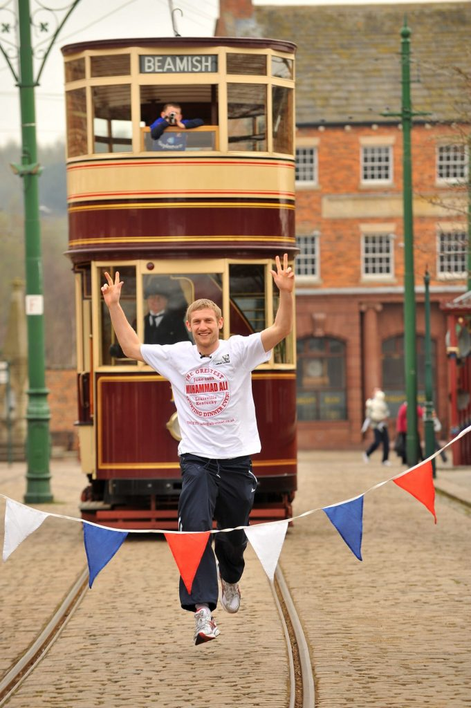PR photography of Olympic Boxer Tony Jeffries racing a Beamish Tram in County Durham