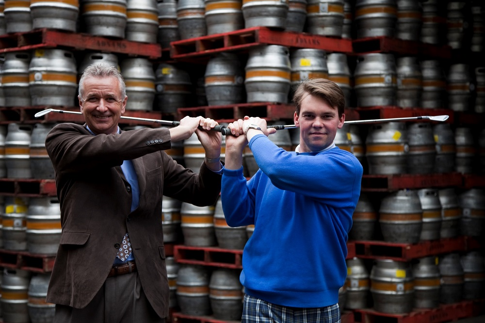 golfers swinging clubs in a brewery