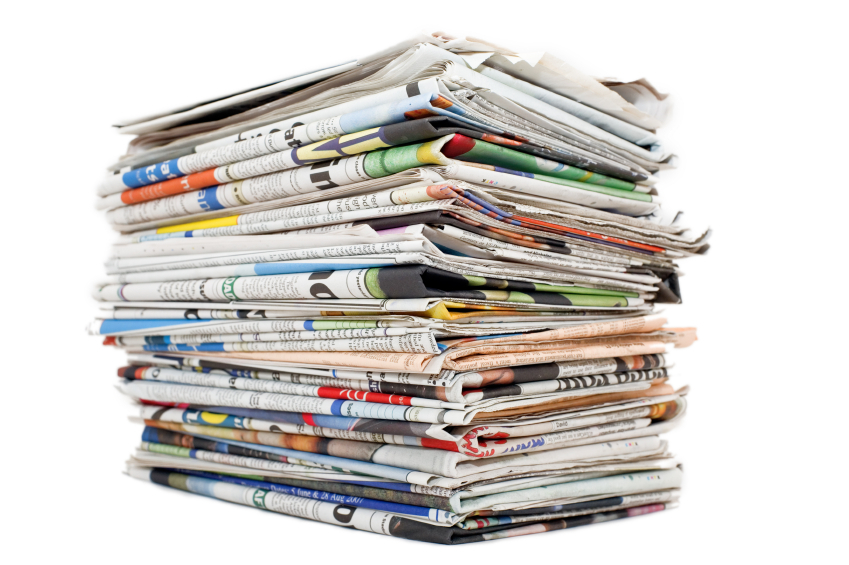 A pile of stacked newspapers