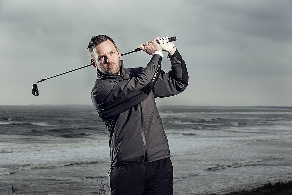 golfer swinging a club